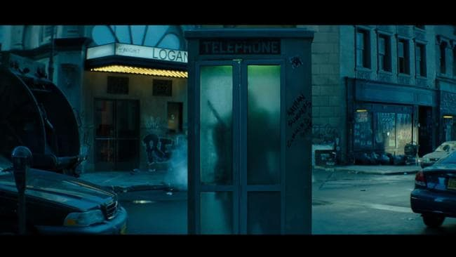 Reynolds spends the majority of the video attempting to change in this phone booth.