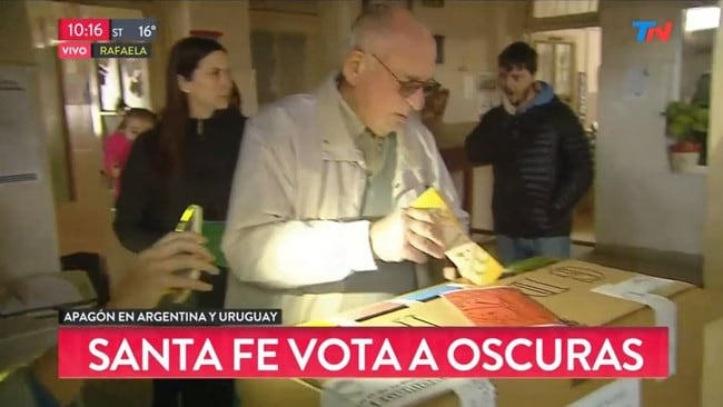 Argentine voters were forced to cast ballots by the light of mobile phones in gubernatorial elections. Picture: Twitter