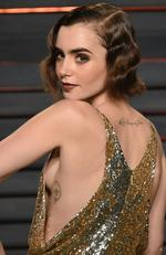 Lily Collins shows off some side boob at the Vanity Fair Oscar Party on Sunday, Feb. 28, 2016, in Beverly Hills, Calif. (Photo by Evan Agostini/Invision/AP)