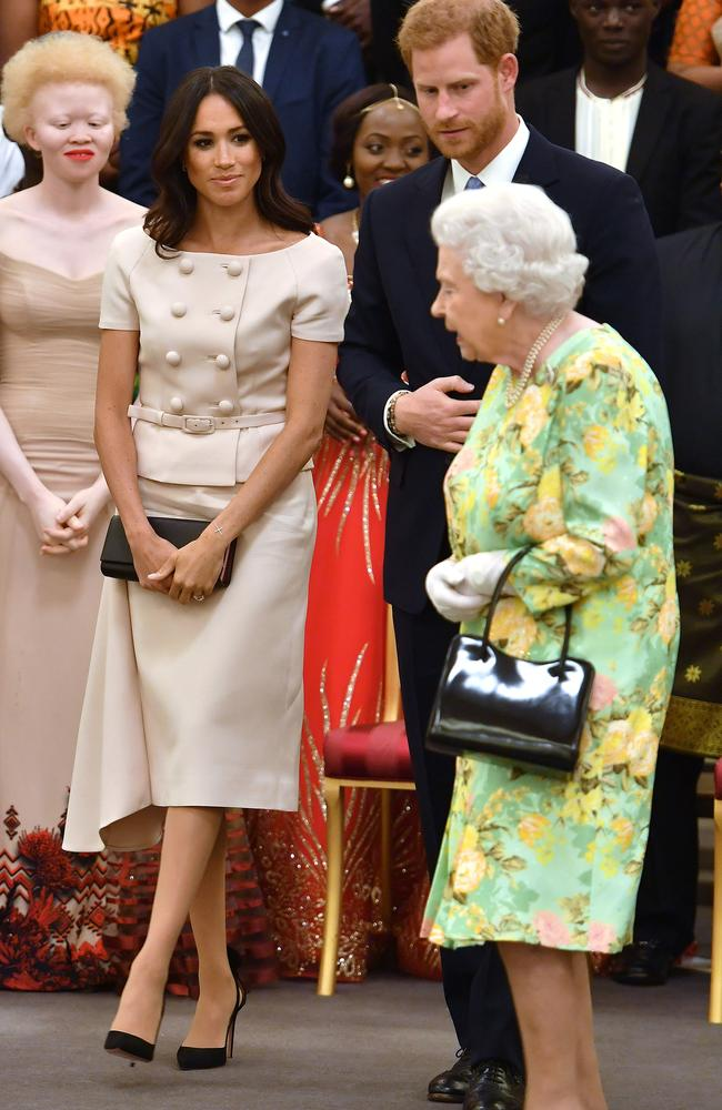 Meghan, Prince Harry and The Queen attend the Queen's Young Leaders Awards Ceremony at Buckingham Palace. Picture: Mega