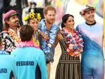 Prince Harry, Duke of Sussex and Meghan, Duchess of Sussex meet Grant Trebilco and Sam Schumacher, founder and co-founder of OneWave, a local surfing community group raising awareness for mental health and wellbeing and Bondi Lifeguards at Bondi Beach on October 19, 2018 in Sydney, Australia. Ryan Pierse/Getty Images