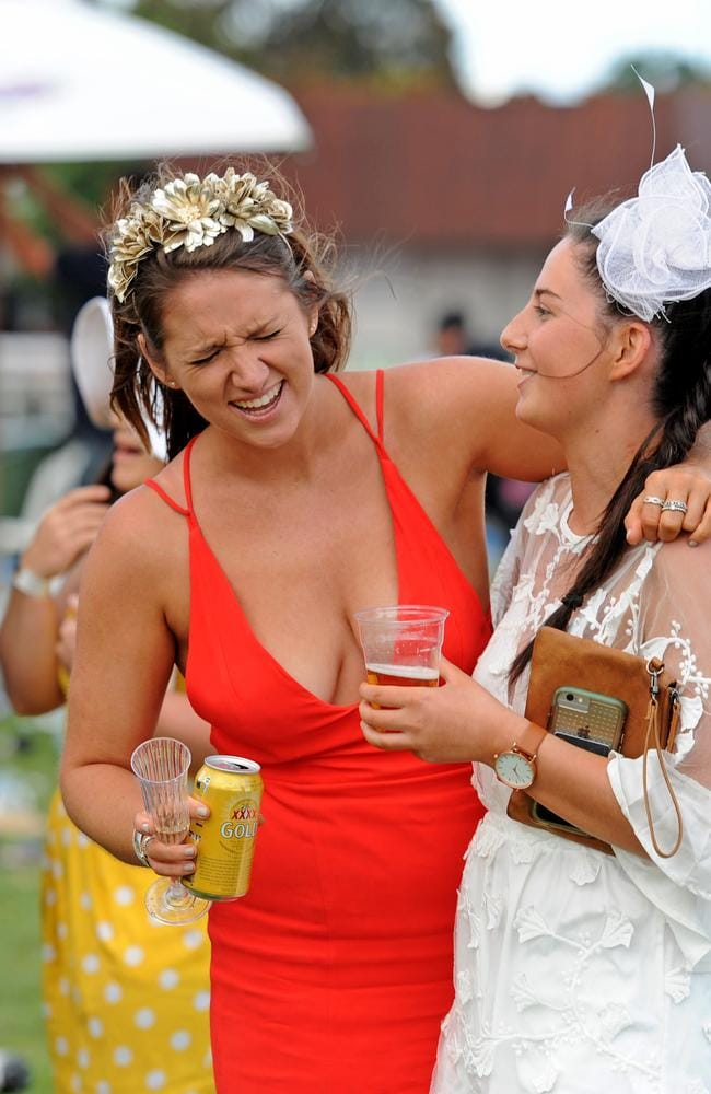 Punters enjoying themselves after the running of the Melbourne Cup, at Flemington Racecourse.