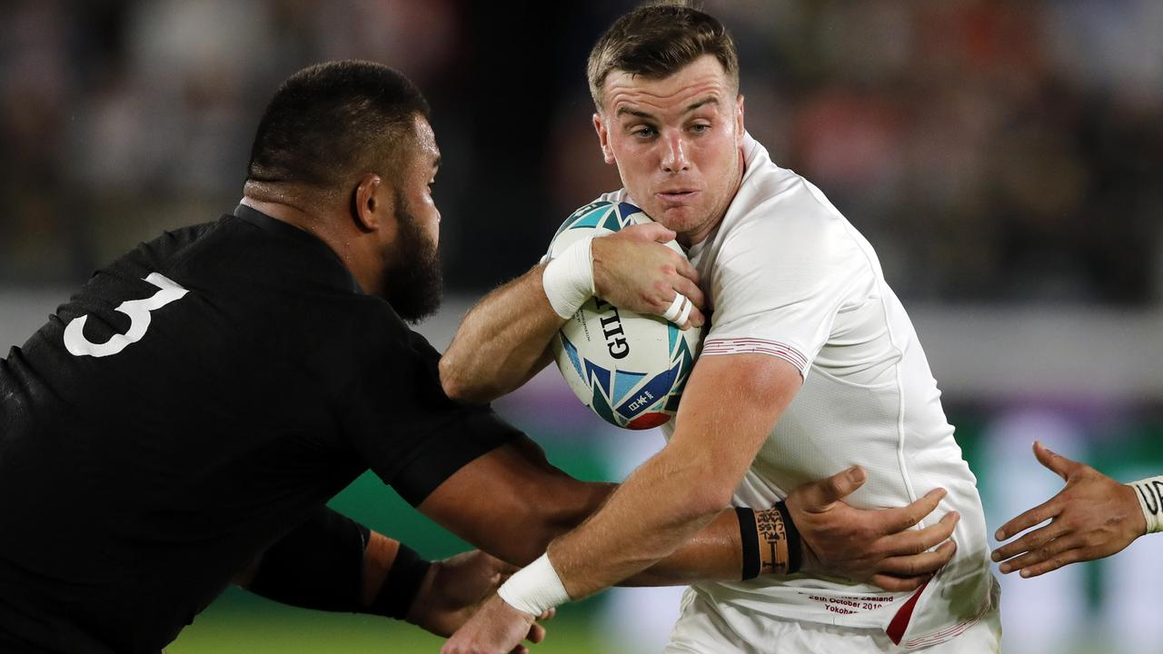 England's George Ford carries the ball against New Zealand's Nepo Laulala.