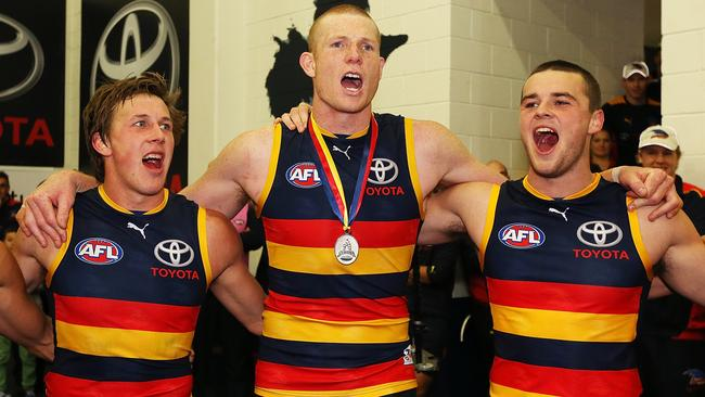 Sam Jacobs won the Showdown Medal and celebrates with Brodie Martin and Brad Crouch.