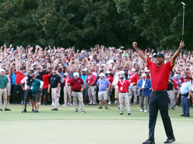 Tiger Woods celebrates the victory.