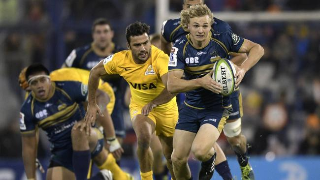 Australia's Brumbies scrum-half Joe Powell (R) is expected to keep the No 9 jersey despite Tomas Cubelli's return.