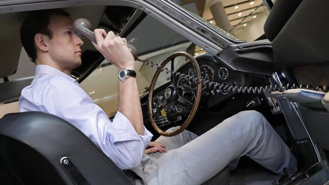 The driver's door mounted phone was never shown in the films.