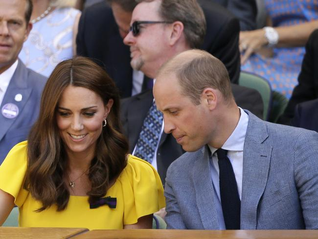 Kate Middleton shared a smile with husband Prince William. Picture: AP Photo/Tim Ireland
