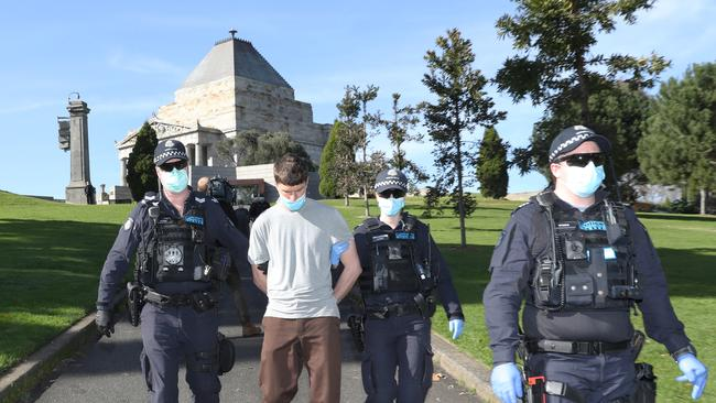 A man is arrested after an anti-mask protest in Melbourne. Picture: David Crosling / NCA NewsWire