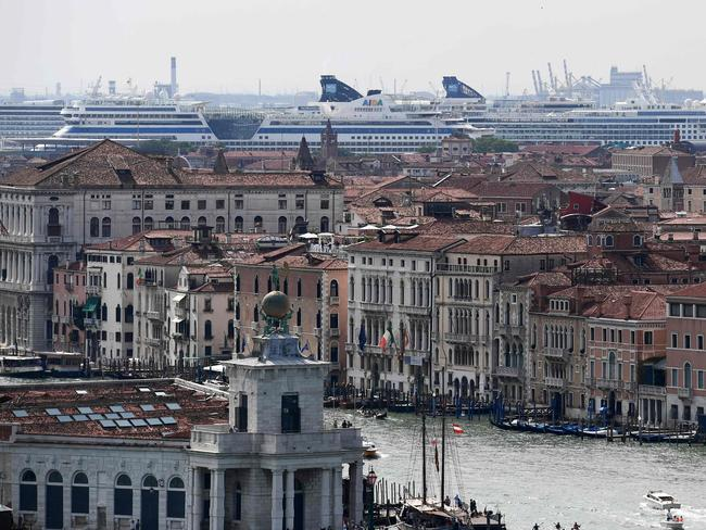 A huge cruise ship dominates the skyline in Venice, where locals are angry about the pollution and damage such ships can create. Picture: Miguel MEDINA / AFP.