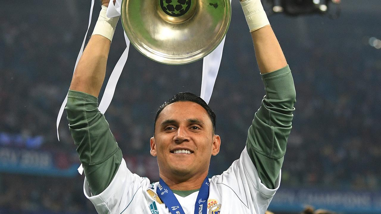 Keylor Navas lifts the Champions League trophy with Real Madrid.
