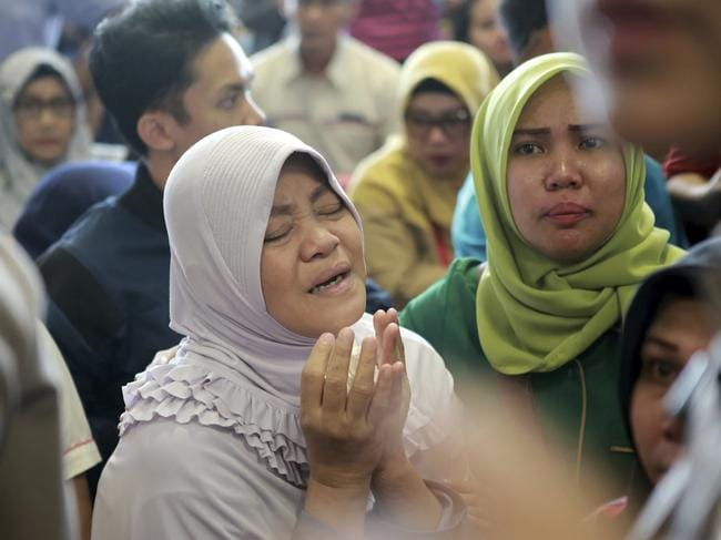 A relative of passengers prays after a Lion Air flight crashed into the ocean. Picture: AP
