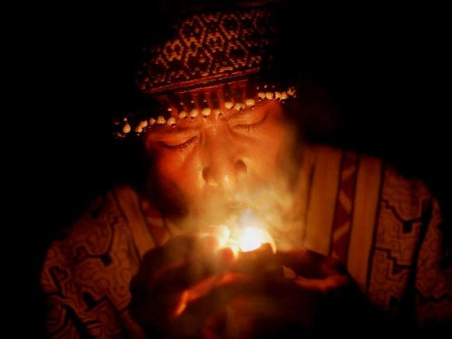 A shaman during an ayahuasca ceremony in the Amazon. Picture: Peace Productions/Abramorama
