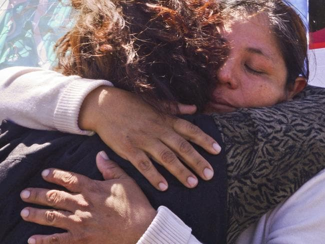 Elena Alfaro, the sister of submarine crew member Federico Ibanez, is comforted outside a naval base, as she waits for news in Mar del Plata, Argentina. Picture: AP Photo/Marina Devo