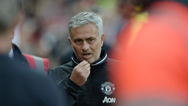Manchester United's Portuguese manager Jose Mourinho (C).