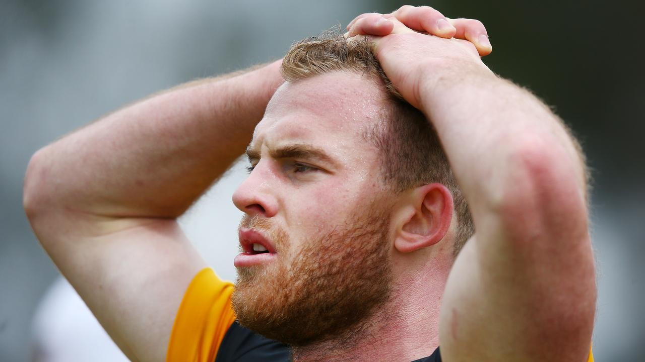 Tom Mitchell recovers after a running set during a pre-season session at Xavier College.