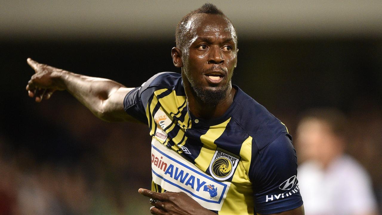 Usain Bolt celebrates scoring. (Photo by PETER PARKS / AFP)