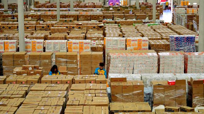 Employees sort items at a storage facility in Shenyang. Picture: STR/AFP