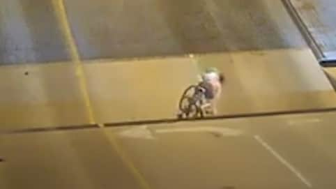 Security camera shows the woman, 37, tumbling into the gap of the rising bridge. Source: Storyful