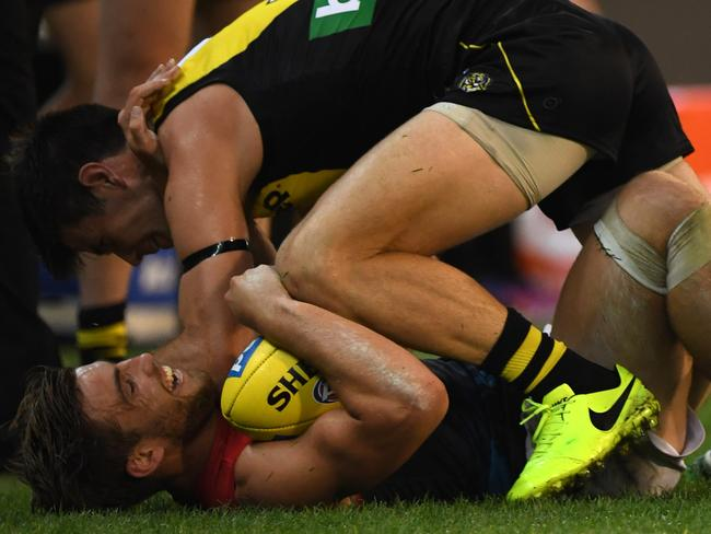 Trent Cotchin (top) and Jack Viney fight . (AAP Image/Julian Smith)