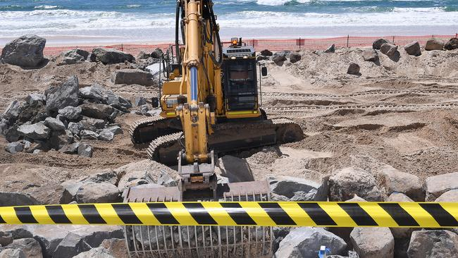 Seawall construction is underway at the Gold Coast as huge swells and dangerous surf have threatened serious erosion of the beaches. Picture: Dave Hunt