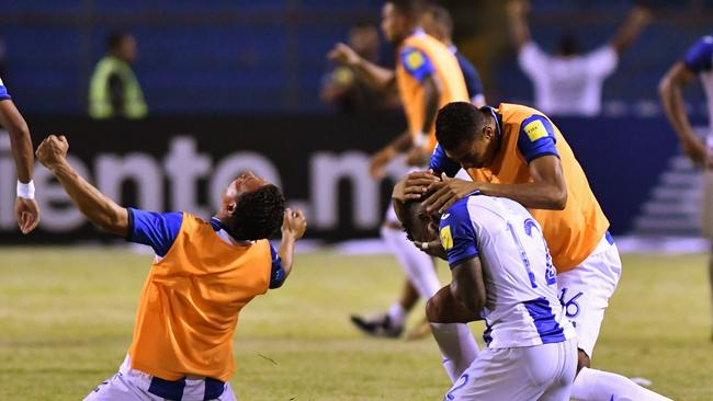 Honduras' Romell Quioto (R) celebrates with teammates after scoring against Mexico.