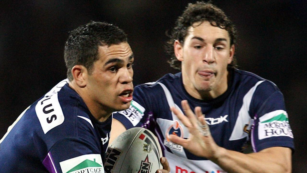 Greg Inglis and Billy Slater in action for Melbourne Storm.