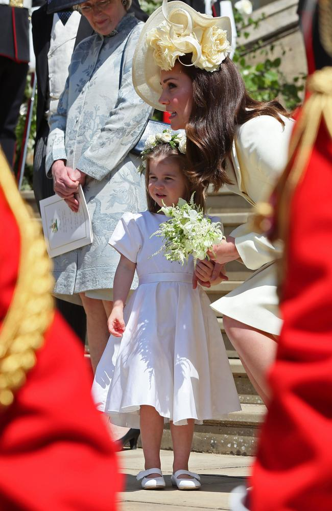 Prince Harry's niece and bridesmaid Princess Charlotte with her mother Britain's Catherine, Duchess of Cambridge. Picture: AFP