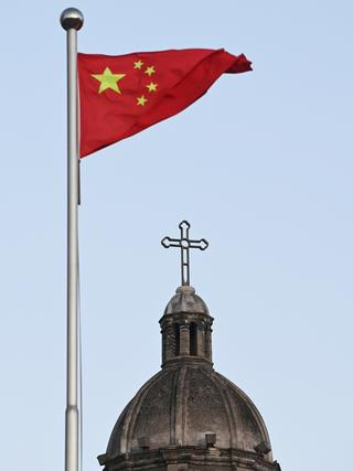 The Chinese national flag flies in front of St Joseph's Church, also known as Wangfujing Catholic Church, in Beijing. Picture: AFP