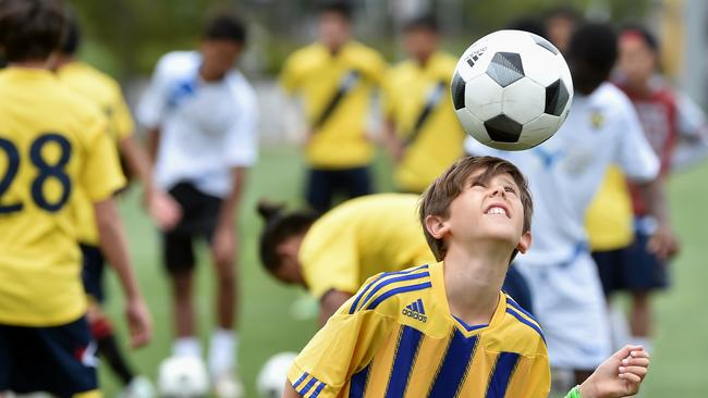 The Soccer Mum: Loves taking photos of her kid's mad skills.