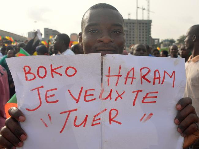 """Fearing for their lives ... A man holds a placard that reads """"Boko Haram, I want to kill you"""" during a demonstrationattended by 10-, 000 to 15,000 people in downtown Yaounde, Cameroon. Picture: AFP / Reinnier Kaze"""
