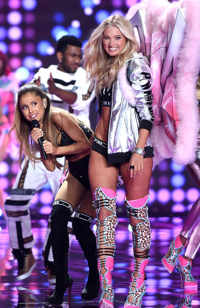 Ariana Grande ducks under the wing of model Elsa Hosk at the 2014 Victoria's Secret fashion show in London. Picture: Karwai Tang, WireImage
