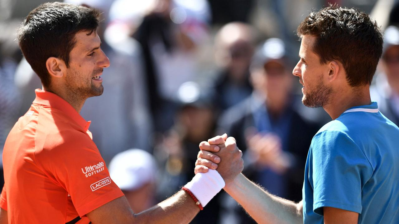Djokovic congratulates Thiem after the Austrian won their 2019 French Open semi-final. (Photo by Philippe LOPEZ / AFP)
