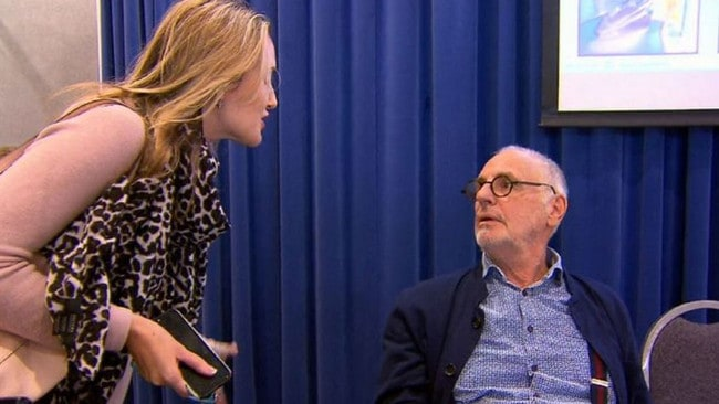 A woman confronts Philip Nitschke at a euthanasia conference. Picture: Nine.