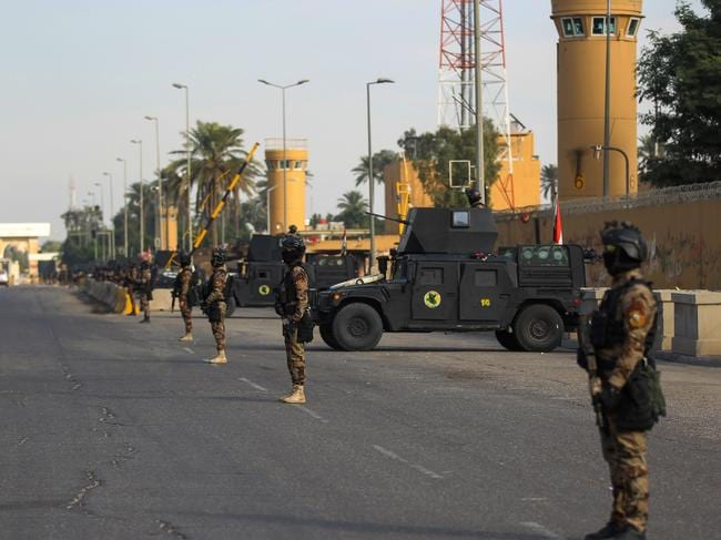 Soldiers at the US embassy in Baghdad after it was attacked. Picture: Ahmad Al-Rubaye/AFP