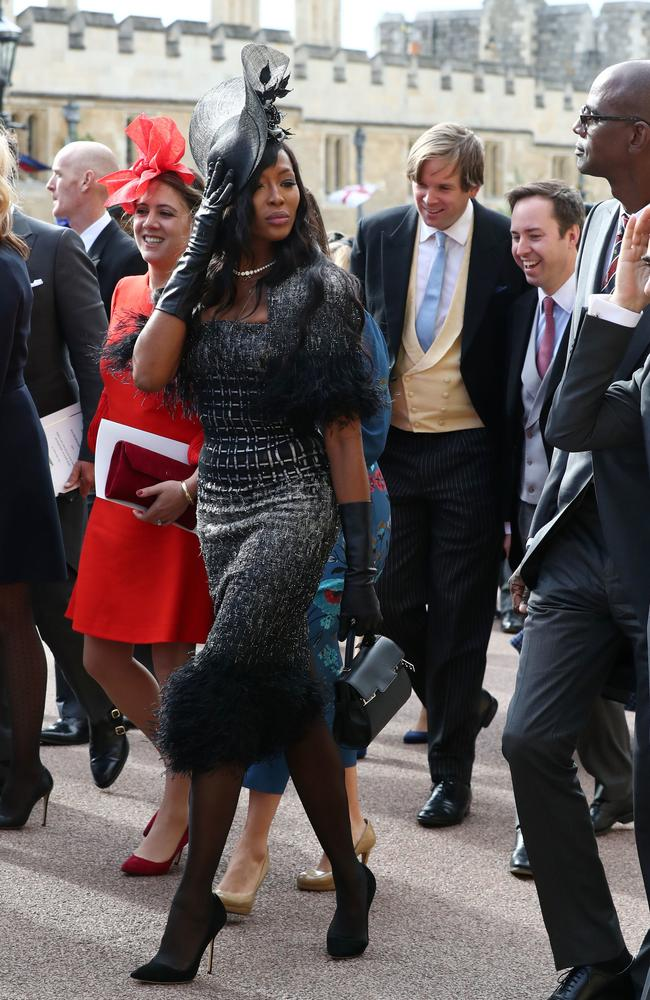 People say you shouldn't wear black to a wedding. But Naomi Campbell does what she damn well wants, as shown by her outfit choice. If somebody had kicked the bucket at the wedding, she could have gone seamlessly into (chic) mourning.