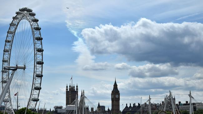 A plane flies over the Palace of Westminster. Picture: Ben Stansall/AFP