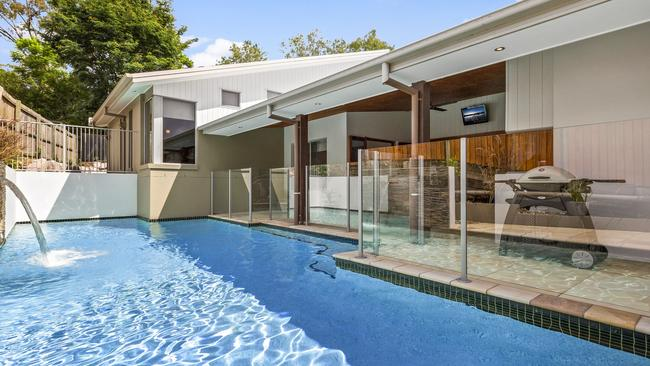 The block is low maintenance and has an inground pool.