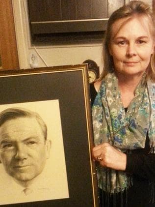 Proud daughter ... Elizabeth McCarthy (nee Jess) with a portrait drawing of her father John Jess done by Paul Kurk in 1972. Picture: Supplied