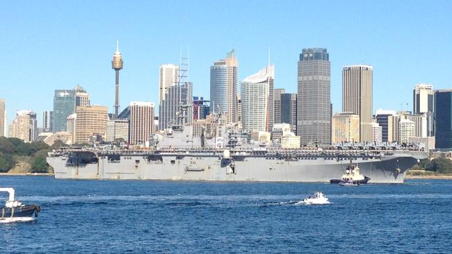"""The docked in Sydney today with more than 3,000 US sailors and marines on board as well as 40 assault helicopters and five Harrier """"Jump Jet'' aircraft. Pic: Danny Aarons"""