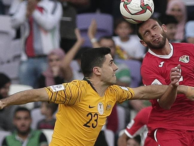 Rogic get tangled with Jordan's defender Feras Shilbaya.