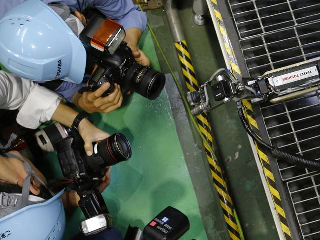Celebrity ... Media take pictures of the robot designed to take pictures inside Fukushima's damaged reactors. Source: AP
