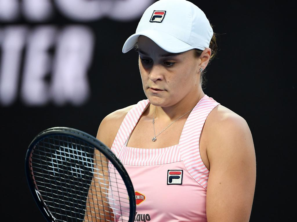 Australia's Ashleigh Barty reacts after a point against Czech Republic's Petra Kvitova during their women's singles quarter-final match on day nine of the Australian Open tennis tournament in Melbourne on January 22, 2019. (Photo by William WEST / AFP) / -- IMAGE RESTRICTED TO EDITORIAL USE - STRICTLY NO COMMERCIAL USE --