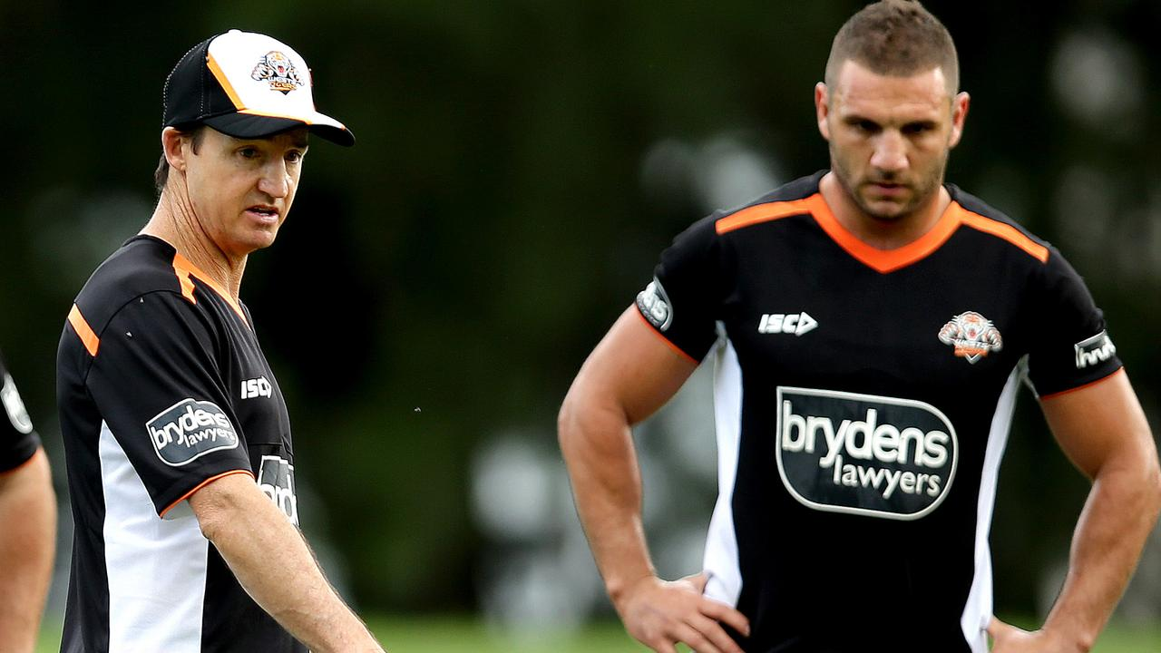 Tigers coach Jason Taylor gives instruction to Robbie Farah and teammates during the Wests Tigers first pre season training session in Leichhardt .Picture Gregg Porteous
