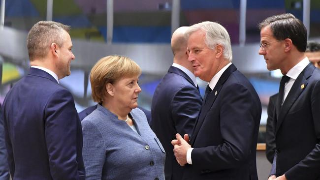 German Chancellor Angela Merkel, centre left, speaks with European Union chief Brexit negotiator Michel Barnier, centre right, and Slovakian Prime Minister Peter Pellegrini, left, during a round table meeting at an EU summit in Brussels. Picture: AP/Geert Vanden Wijngaert