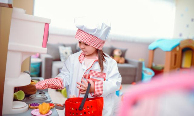 Toddler Girls Playing Cooking Chef with Toys in a Preschool Classroom