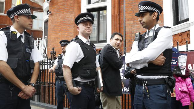 British police arrive and guard the Ecuadorean Embassy as protesters in support Assange demonstrate outside the embassy in London on May 20, 2019. Picture: AFP
