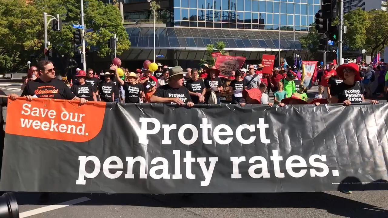 Thousands march through streets of Brisbane in Australia's largest Labour Day rally