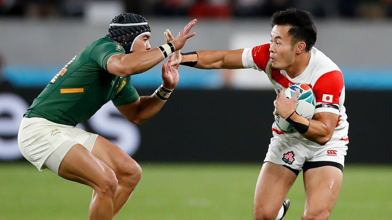 Japan's Kenki Fukuoka fends off a tackle by South Africa's Cheslin Kolbe in Tokyo.