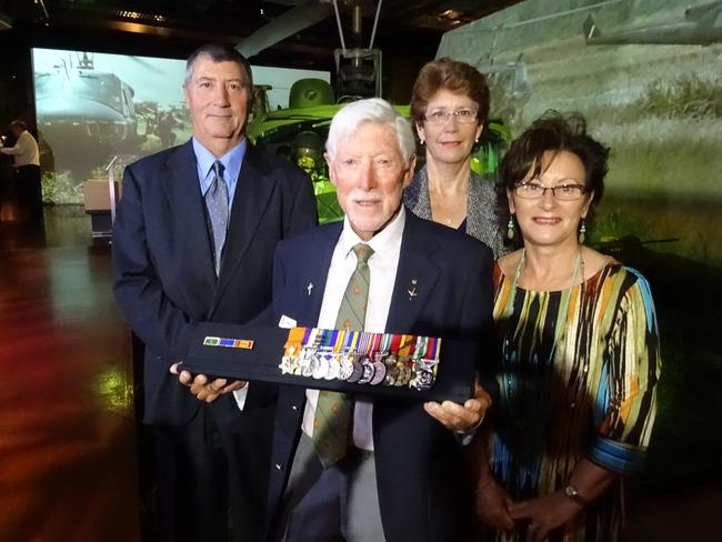 The long fight: Long Tan commander Harry Smith with his medals displayed at the Australian War Memorial and his children Brett, Deborah and Sharon. Picture: supplied
